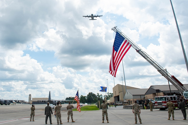 Photo of an aircraft flying over a military base