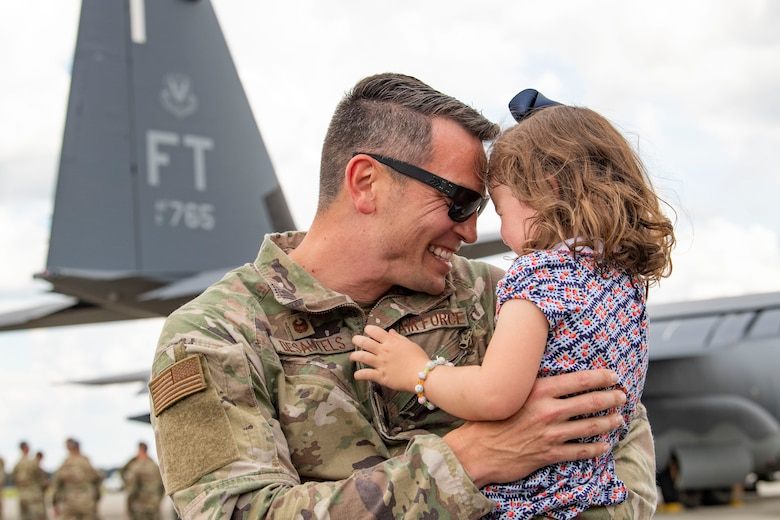 Photo of an Airman and his child