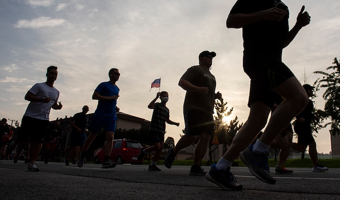Military service members and dependents participate in a 9/11 Memorial 5k run, Sept. 9, 2021 at Osan Air Base, Republic of Korea. Prior to the start of the 5k memorial run, more than 100 participants paused to remember the fallen from Sept. 11, 2001. (U.S. Air Force photo by Tech. Sgt. Vernon Young Jr.)