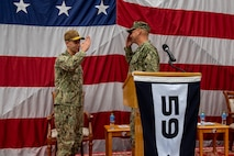 Vice Adm. Brad Cooper, left, commander of U.S. Naval Forces Central Command, U.S. 5th Fleet and Combined Maritime Forces, salutes Capt. Michael D. Brasseur, the first commodore of Task Force (TF 59) during a commissioning ceremony for TF 59 onboard Naval Support Activity Bahrain, Sept. 9. TF 59 is the first U.S. Navy task force of its kind, designed to rapidly integrate unmanned systems and artificial intelligence with maritime operations in the U.S. 5th Fleet area of operations.