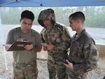 Sgt. Joemicheal Cristobal, Spc. Osias Passi, and Spc. Brennon Westfall, members of the Alaska Army National Guard and Task Force-Alaska, log trailer and driver information at a transportation yard in Roseland, Louisiana, Sept. 7, 2021. They are among 17 Alaska Guardsmen assisting the Louisiana National Guard and civil authorities in the aftermath of Hurricane Ida.