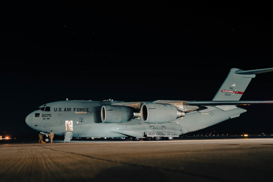 A West Virginia Air National Guard C-17 Globemaster lll carrying Afghanistan evacuees arrives at Naval Air Station Sigonella in Italy Aug. 22, 2021. Two aircrews from the 167th Airlift Wing transported passengers and cargo into and out of Hamid Karzai International Airport in Kabul.
