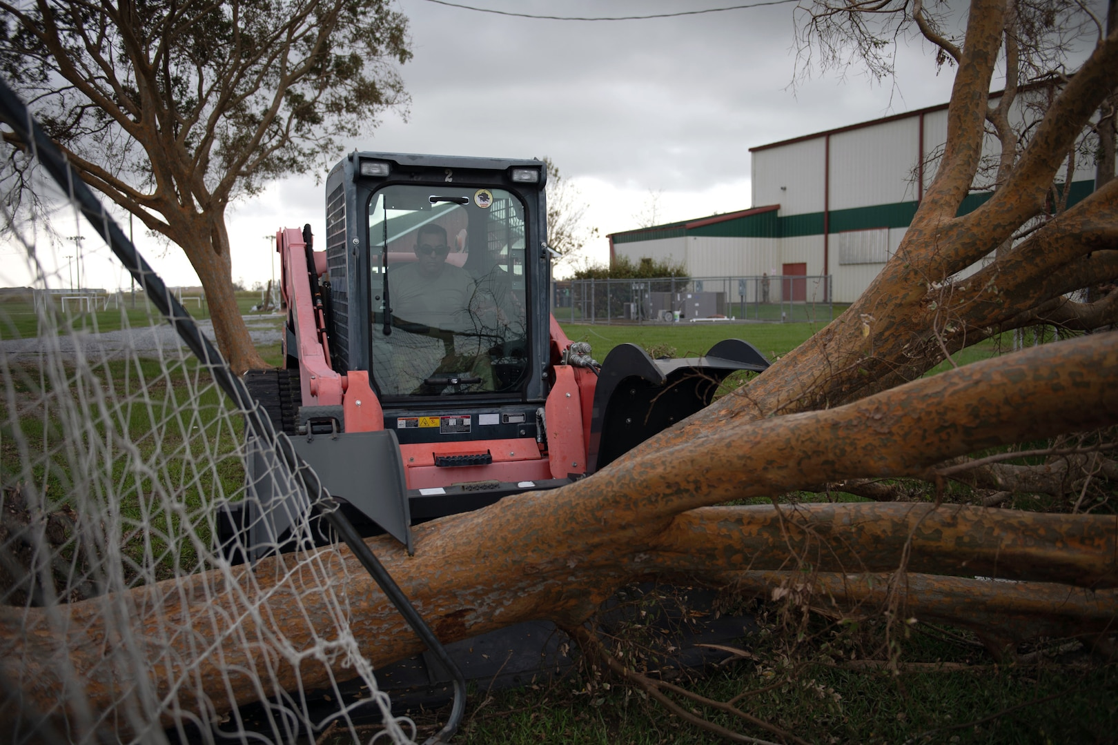 Members of the 149th Fighter Wing help clean up the Raceland Community Center in Raceland, Louisiana, during Hurricane Ida response Sept. 6, 2021.