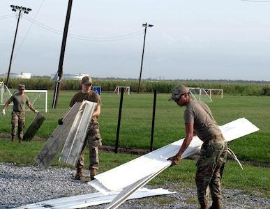 Members of the 149th Fighter Wing help clean up the Raceland Community Center in Raceland, Louisiana, during Hurricane Ida response Sept.6, 2021.