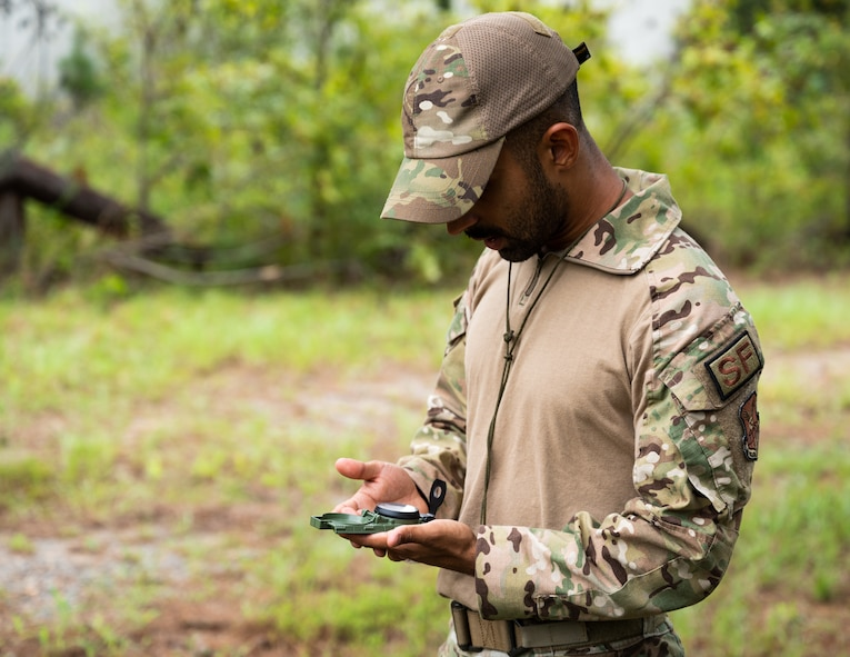 Staff Sgt. Somalier Vierra-Martinez, 2nd Security Forces Squadron installation patrolman, plots a point using a compass at Barksdale Air Force Base, Louisiana, Aug. 30, 2021.