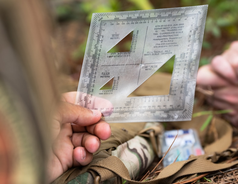 An Airman from the 2nd Security Forces Squadron makes use of a military protractor at Barksdale Air Force Base, Louisiana, Aug. 30, 2021.