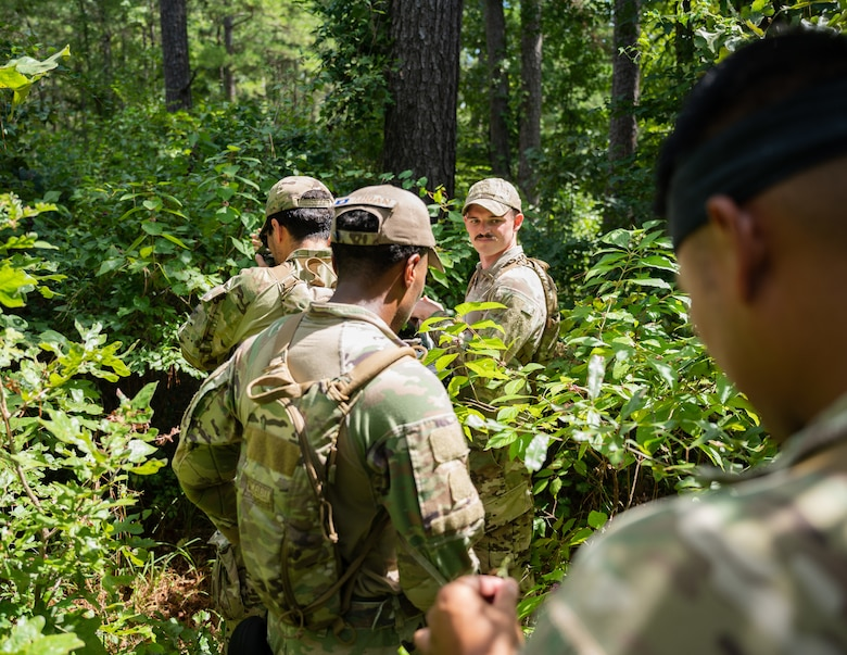 Airmen from the 2nd Security Forces Squadron navigate the east reservation wilderness at Barksdale Air Force Base, Louisiana, Aug. 30, 2021.