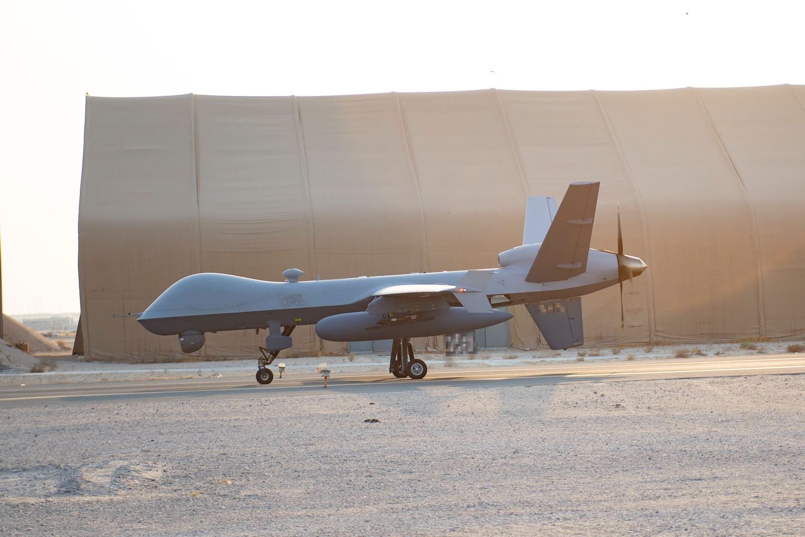 An MQ-9 Reaper taxis at Ali Al Salem Air Base, Kuwait, Aug. 20, 2021. The MQ-9 reaper is capable of carrying munitions, following high value targets for days at a time, has an extended loiter time and can be piloted mostly by itself. (U.S. Air Force Illustration by Senior Airman Helena Owens)