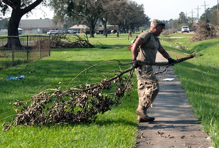 Members of the 149th Fighter Wing help clean up Thibodaux High School in Thibodaux, Louisiana, during Hurricane Ida response Sept. 4, 2021.