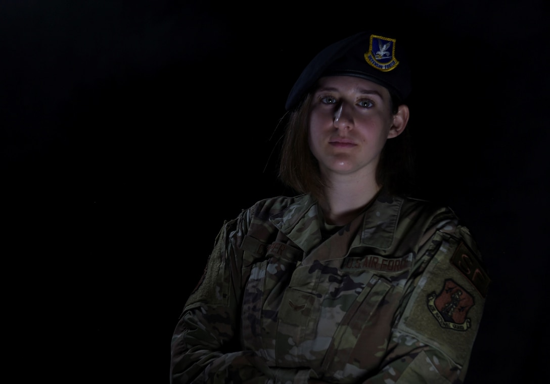 Airman First Class Alexis Cooper, 132d Security Forces Squadron, was born after 9/11 and was taught about the event in school. Cooper's father served in the 132d Wing overseas and was instrumental in inspiring Cooper serve in the military. (U.S. Air National Guard photo by Tech. Sgt. Michael J. Kelly)