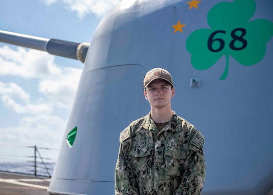 Information Systems Technician 3rd Class Matthew Coyle, poses for a portrait on the foc'sle of the guided-missile destroyer USS The Sullivans (DDG 68). (U.S. Navy photo by Ens. Kelly Harris)