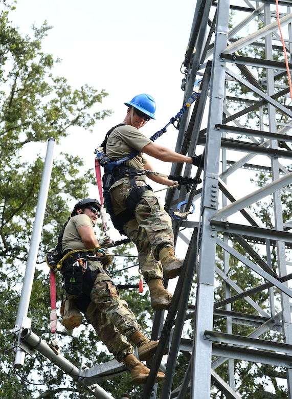 U.S. Air Force Col. William Hunter, 81st Training Wing commander, participates in a tower climbing demonstration with the assistance of Staff Sgt. Austin Johnson, 85th Engineering Installation Squadron cable and antenna systems technician, during an 85th EIS immersion tour behind Maltby Hall at Keesler Air Force Base, Mississippi, Sept. 1, 2021. The purpose of the tour was to become more familiar with the squadron's mission and its capabilities. (U.S. Air Force photo by Kemberly Groue)
