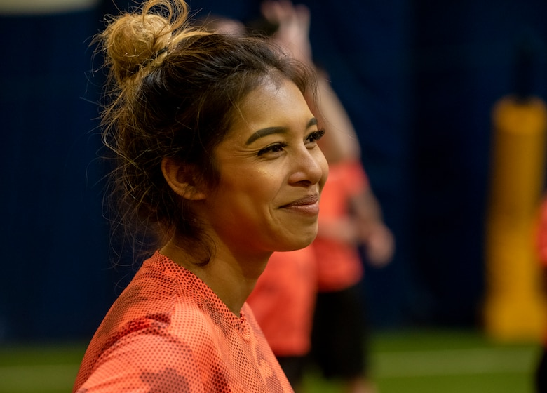 A service member smiling during the Denver Broncos Training camp.