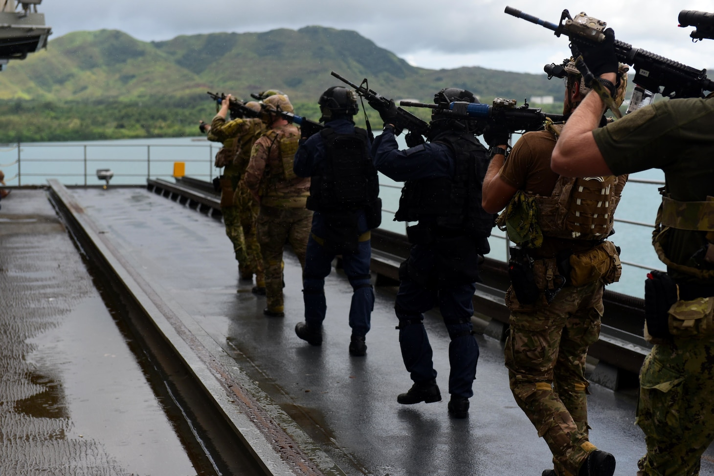 U.S. Naval Special Warfare operators and Japan Maritime Self-Defense Force sailors conduct a simulated visit, board, search, and seizure of USS Frank Cable (AS-40) as part of MALABAR 2021. MALABAR 2021 is an example of the enduring partnership between Australian, Indian, Japanese and American maritime forces, who routinely operate together in the Indo-Pacific, fostering a cooperative approach toward regional security and stability. Naval Special Warfare is the nation's premiere maritime special operations force and is uniquely positioned to extend the Fleet's reach and deliver all-domain options for naval and joint force commanders.