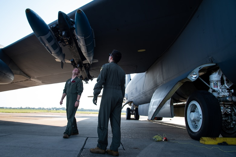 Maj. James Bell, 96th Bomb Squadron aircraft commander, and Capt. Phillip Hightower, 96th BS co-pilot, inspect conventional munitions before takeoff at Barksdale Air Force Base, Louisiana, Aug. 25, 2021. Inspecting munitions is part of an important pre-flight checklist vital to ensuring flight safety and proper weapon functionality. (U.S. Air Force photo by Airman 1st Class Chase Sullivan)