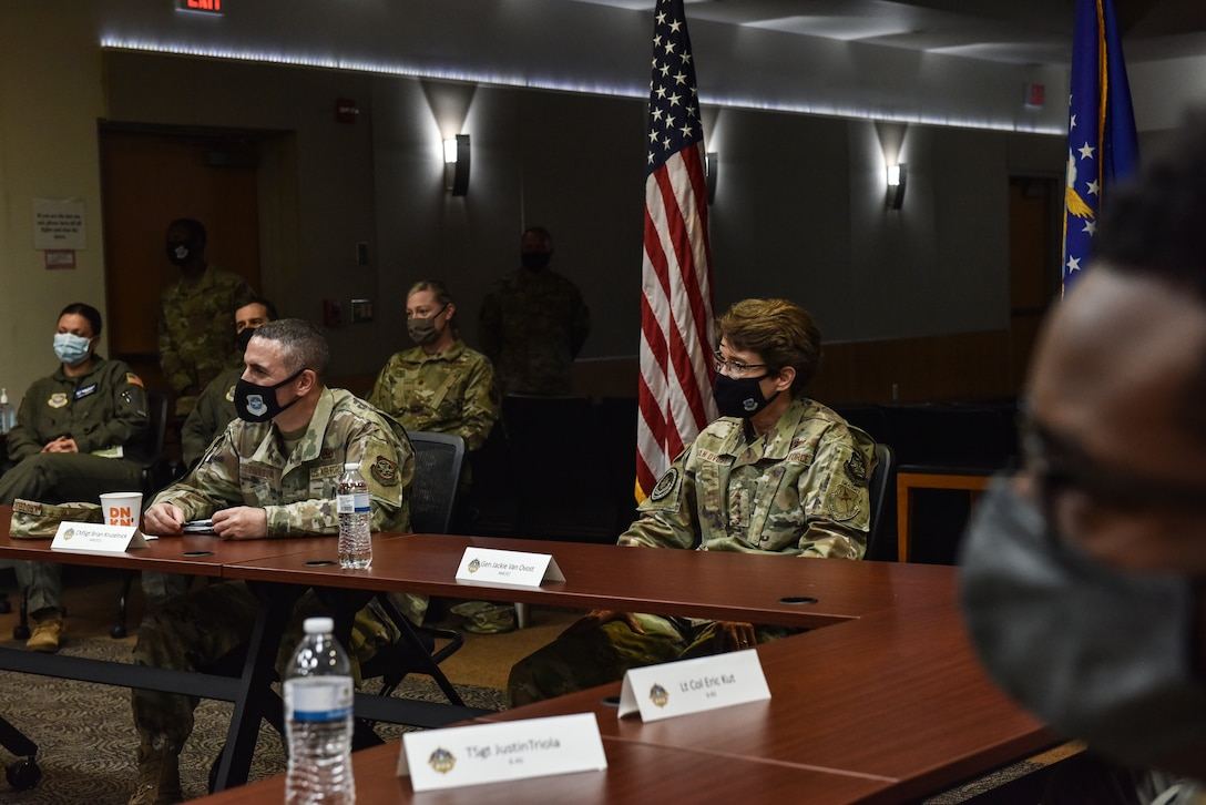 U.S. Air Force Gen. Jacqueline D. Van Ovost, Air Mobility Command commander, and Chief Master Sgt. Brian Kruzelnick, AMC command chief, speak with 305th Air Mobility Wing Airmen about their experiences participating in Operation Allies Refuge during a visit to Joint Base McGuire-Dix-Lakehurst, N.J., Sept. 8, 2021. 305th AMW crews were instrumental to the Operation Allies Refuge mission and were among the first to help evacuate. (U.S. Air Force Photo by Staff Sergeant Shay Stuart)