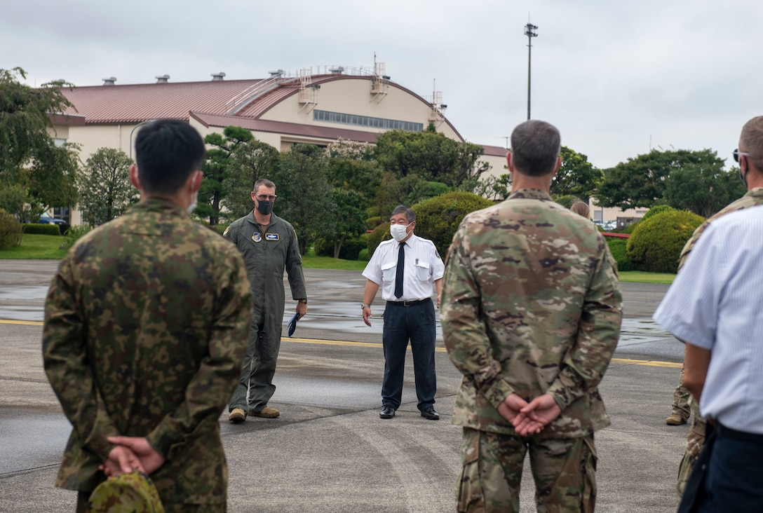A U.S. Air Force officer thanks attendees and supporting personnel for participating in Yokota's first Helicopter Symposium