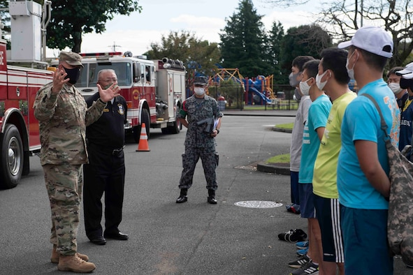 Col. Patrick Launey, 374th Mission Support Group commander, addresses participants of the 10th annual Yokota Fire Emergency 9/11 Tower Run at Yokota Air Base, Japan, Sept. 10, 2021.