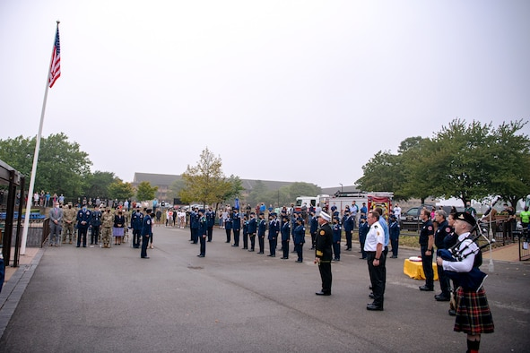 Airmen from the 501st Combat Support Wing, Cadets from the Alconbury Middle High School JROTC along with guests, attend a 9/11 remembrance ceremony at RAF Alconbury, England, Sept. 9, 2021. Airmen, Cadets and guests came together to pay homage to those who lost their lives during the Sept. 11, 2001, attacks. (U.S. Air Force photo by Senior Airman Eugene Oliver)