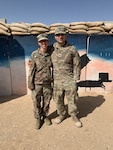 West Virginia Army National Guard Cpt. Brittany Watson, a medical operations officer in the 111th Engineer Brigade, and Sgt. Andres Rivera, a carpentry and masonry specialist in the 766th Engineer Company of the 111th, recently reunited during a deployment to the Middle East. They had not seen each other in over 12 years.