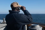 (Sept. 8, 2021) Boatswain's Mate 2nd Class Anthony Harris stands a lookout watch aboard the Arleigh Burke-class guided-missile destroyer USS Arleigh Burke (DDG 51), Sep. 8, 2021. Arleigh Burke, forward-deployed to Rota, Spain, is on its first patrol in the U.S. Sixth Fleet area of operations in support of U.S. national security interests and regional allies and partners in Europe and Africa.