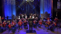 """In honor of the 20th anniversary of 9/11, """"The President's Own"""" United States Marine Band premieres an original piece of music composed by Assistant Director Maj. Ryan J. Nowlin. In a special video production, the composition's first performance was captured under the glowing stained glass of the Washington National Cathedral, while being played by the Marine Chamber Orchestra accompanied by a Joint Armed Forces Chorus. The piece takes its name, """"These Lights, Which Shine,"""" from a translation of a poem by Hannah Senesh titled """"There are Stars."""""""