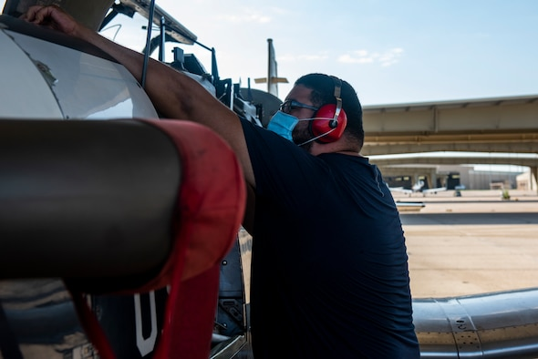Jerry Martinez, 47th 47th Flying Maintenance Directorate aircraft mechanic, examines the engine of a Texan II T-6 aircraft to ensure it is suitable for flight, at Laughlin Air Force Base, Texas on Sept. 8, 2021. National Hispanic Heritage Month is a period from September 15 to October 15 in the United States for recognizing the contributions and influence of Hispanic Americans to the history, culture, and achievements of the United States.
