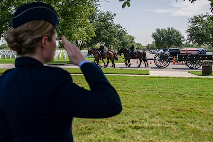 Soldiers with the Fort Sam Houston Caisson Section carry the flag-draped remains of Col. Richard E. Cole during his interment ceremony, Sept. 7, 2021.