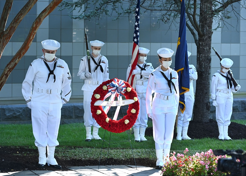 SUITLAND, Md. (September 10, 2021) The Office of Naval Intelligence (ONI) honor guard flanks a memorial wreath during the 9/11 20th anniversary ceremony at the National Maritime Intelligence Center. Eight ONI shipmates serving in the Chief of Naval Operations Intelligence Plot in the Pentagon perished during the terrorist attacks that day: Cmdr. Dan Shanower, Lt. Cmdr Vince Tolbert, Lt. Jonas Panik, Lt. Darin Pontell, Petty Officer 1st Class Julian Cooper, Angela Houtz, Brady Howell, and Gerard Moran.
