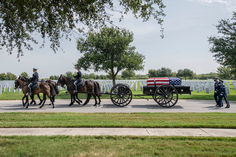 Soldiers with the Fort Sam Houston Caisson Section carry the flag-draped remains of Col. Richard E. Cole during his interment ceremony Sept. 7 at the Fort Sam Houston National Cemetery, Texas.