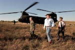 Left to right, Maj. Gen. William Lynch, Pennsylvania National Guard adjutant general; Pennsylvania Gov. Tom Ridge; and Pennsylvania State Police Commissioner Paul Evanko leave a CH-47 Chinook helicopter from the Pennsylvania National Guard's Company G, 104th Aviation Regiment, at the Flight 93 crash site in Somerset County, Pennsylvania, Sept. 11, 2001. (Photo by Terry Way/Commonwealth Media Services)