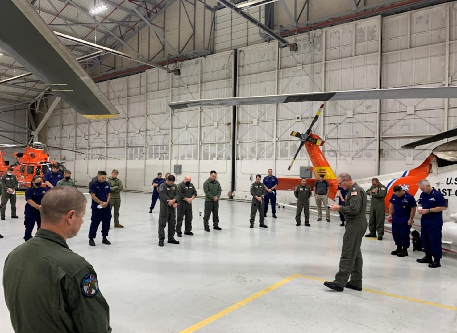 Chaplain Doyle Allen leading aircrews from around the CG (to include the Atlantic Area Commander and CMC) in a prayer for courage, strength, and protection – just moments before launching on recovery missions after Hurricane Ida passage.