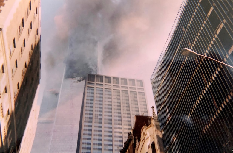Smoke and flames come from the Twin Towers Sept. 11, 2001, at the World Trade Center, New York City, New York. This photo was captured with a disposable camera purchased specifically to capture events as they unfolded in front of Col. Ephod Shang, vice commander of the 367th Recruiting Group and deputy director at the AFRC Headquarters for Recruiting on Robins AFB, Georgia, when he was a newly minted captain at the time.