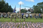 The color guard presents the flag during a 9/11 remembrance ceremony at New York National Guard headquarters in Latham, New York Sept. 10, 2021. The ceremony took place in front of a backdrop of 2,977 small American flags representing each of the people killed during the Sept. 11, 2001, attacks.