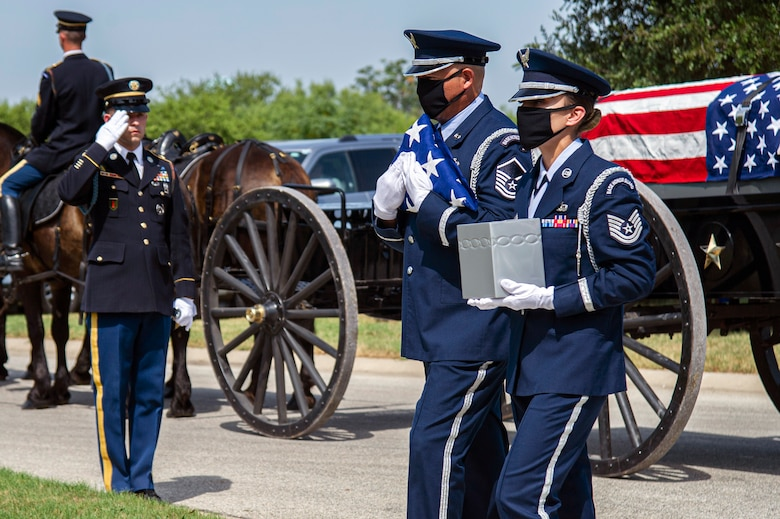 Air Force Honor Guard members carry the remains of retired Col. Richard E. Cole  and the U.S. flag during his interment, Sept. 7, 2021.