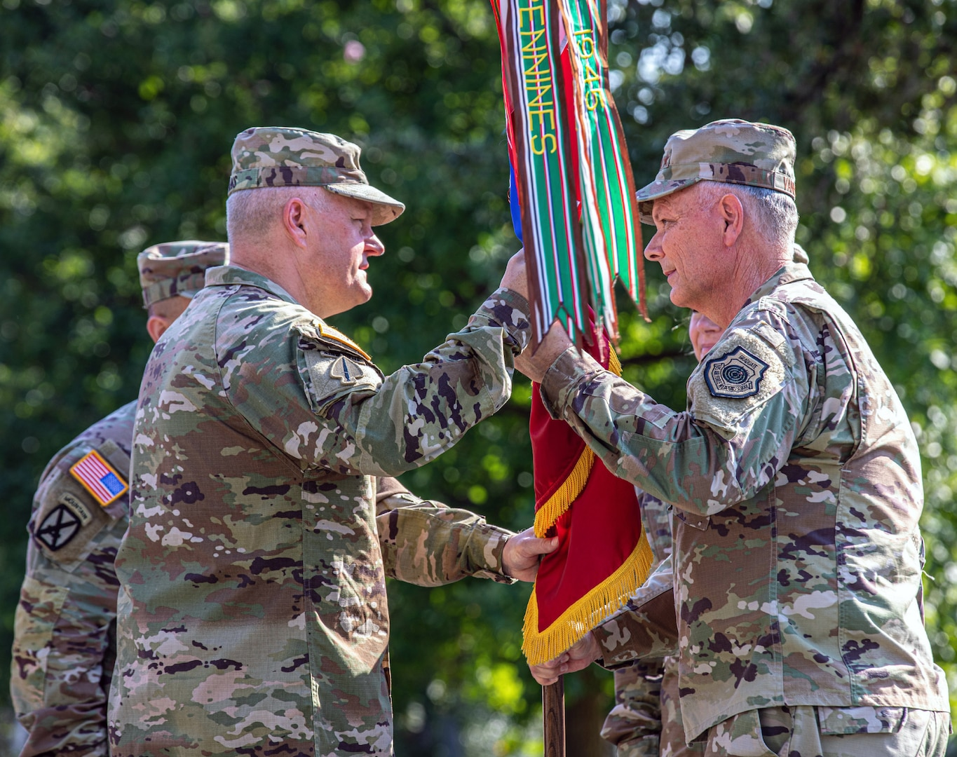 Gen. Glen D. VanHerck (right), Commander, North American Aerospace Defense Command and United States Northern Command, passes the U.S. Army North colors to Lt. Gen. John R. Evans, Jr.