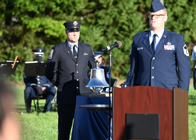 Bradley Reppert of the Fire Department of New York sounds a bell during a 9/11 memorial ceremony on Joint Base Anacostia-Bolling, Washington D.C. on Sept. 10, 2021. Mission partners from across the National Capitol Region gathered at JB Anacostia-Bolling to honor those who died 20 years ago during the terror attacks on the World Trade Center and the Pentagon on September 11, 2001. (U.S. Air Force photo by Staff Sgt. Kayla White)