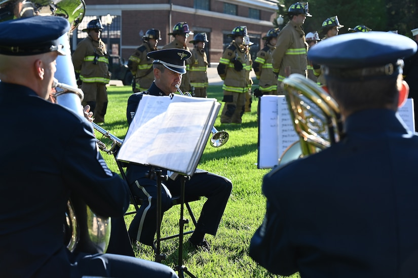 U.S. Air Force Tech. Sgt. Jason Covey plays with other members of The United States Air Force Band during a 9/11 memorial ceremony on Sept. 10, 2021 at Joint Base Anacostia-Bolling, Washington D.C. Mission partners from across the National Capitol Region gathered at JB Anacostia-Bolling to honor those who died 20 years ago during the terror attacks on the World Trade Center and the Pentagon on September 11, 2001. (U.S. Air Force photo by Staff Sgt. Kayla White)