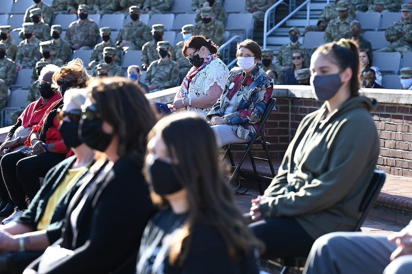 Surviving members of the Earhart family observe a 9/11 memorial ceremony at Joint Base Anacostia-Bolling, Washington D.C. on Sept. 10, 2021. The Earhart and Golinski families attending the ceremony both lost loved ones during the terrorist attack on the Pentagon twenty years ago. Mission partners from across the National Capitol Region gathered at JB Anacostia-Bolling to honor those who died during the terror attacks on the World Trade Center and the Pentagon on September 11, 2001. (U.S. Air Force photo by Staff Sgt. Kayla White)