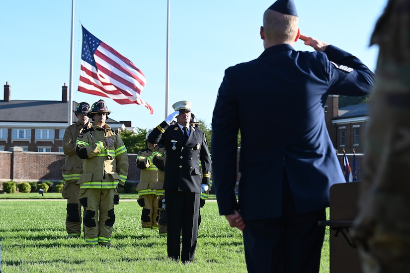 Battalion Fire Chief for the Naval District Washington Jeffrey Roberts salutes during the playing of Taps during a 9/11 memorial ceremony on Sept. 10, 2021 at Joint Base Anacostia-Bolling, Washington D.C. Mission partners from across the National Capitol Region gathered at JB Anacostia-Bolling to honor those who died 20 years ago during the terror attacks on the World Trade Center and the Pentagon on September 11, 2001. (U.S. Air Force photo by Staff Sgt. Kayla White)