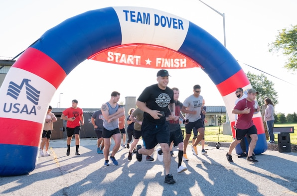 """Runners leave the starting line at the """"I've Got Your Six"""" 5k at Dover Air Force Base, Delaware, Sept. 10, 2021. Almost 30 Team Dover Airmen and civilians participated in the event. (U.S. Air Force photo by Mauricio Campino)"""