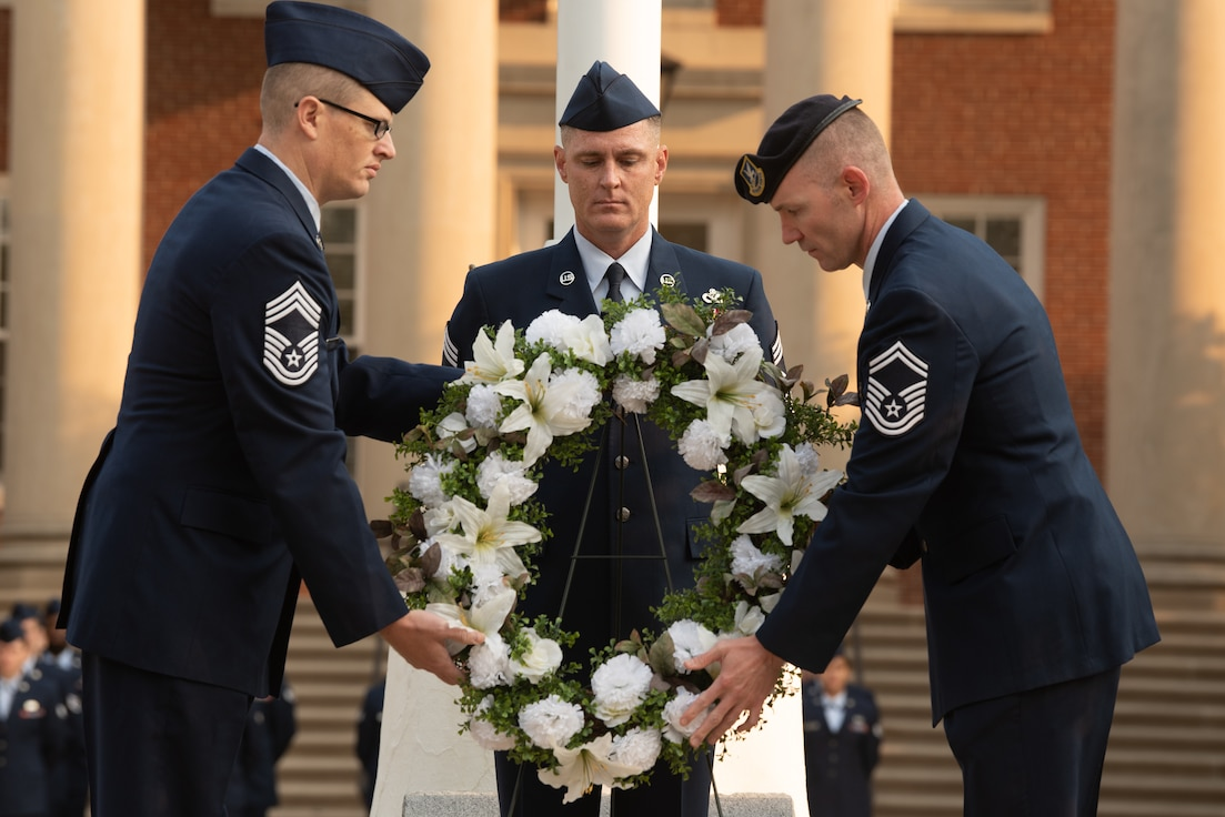 Senior enlisted leaders place a wreath as a tribute for the lives lost on September 11, 2001 at the 9/11 remembrance ceremony on Scott Air Force Base, Illinois, September 10, 2021. The ceremony was held to remember the 2,996 victims of the terrorist attacks that occurred on September 11, 2001. (U.S. Air Force photo by Airman 1st Class Stephanie Henry)