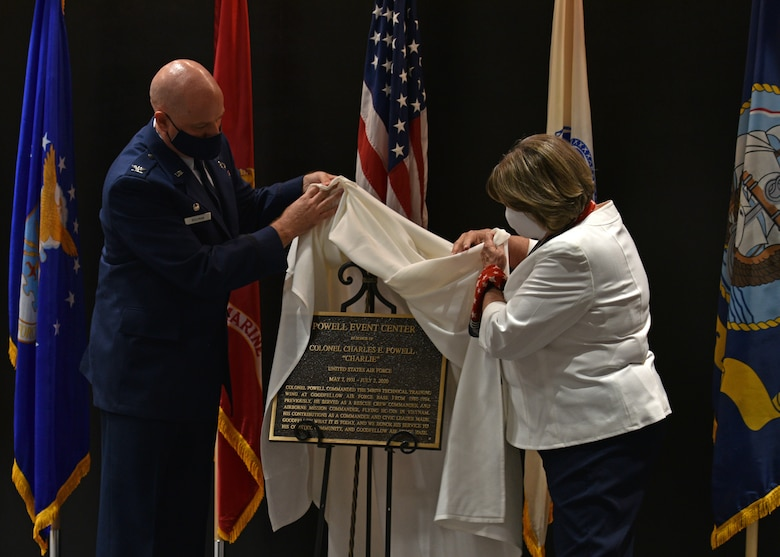 U.S. Air Force Col. Matthew Reilman, 17th Training Wing commander, and Theresa Ann McKinney, daughter of U.S. Air Force Retired Col. Charles E. Powell and JoAnne Powell, unveil the dedication plaque during the Powell Event Center dedication ceremony on Goodfellow Air Force Base, Sept. 10, 2021. Theresa and several family members were in attendance to remember and honor the legacy of Charles and JoAnne Powell. (U.S. Air Force photo by Senior Airman Ashley Thrash)