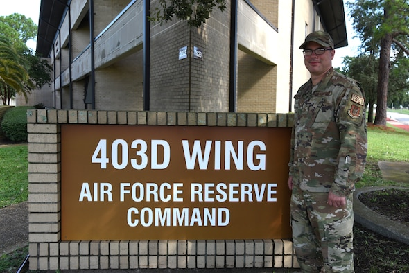 """Master Sgt. Jared Bryant, 403rd Force Support Squadron first sergeant, is the first full-time first sergeant, or """"shirt,"""" to work for the 403rd Wing. He serves as an Active Guard Reserve, in the role of the 403rd Wing's Resiliency First Sergeant during the month and the 403rd FSS first sergeant during unit training assembly weekends. (U.S. Air Force photo by Jessica Kendziorek)"""