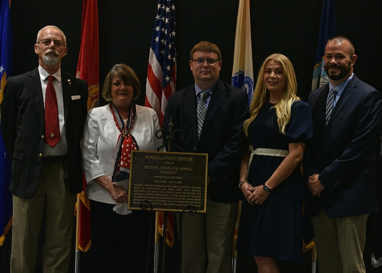 Family members of U.S. Air Force Retired Col. Charles E. Powell and JoAnne Powell, stand with the dedication plaque during the Powell Event Center dedication ceremony on Goodfellow Air Force Base, Sept. 10, 2021. Charles Powell was the commander of the 3480th Technical Training Wing at Goodfellow AFB from 1980-1984. (U.S. Air Force photo by Senior Airman Ashley Thrash)
