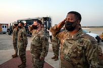 Members of the 502nd Air Base Wing salute as the U.S. flag is lowered to half-staff at Joint Base San Antonio-Lackland Sept. 10 in honor of those lost in the terrorist attacks of Sept. 11, 2001.