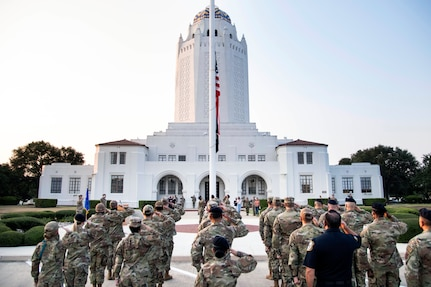 Members of the 502nd Air Base Wing salute as the U.S. flag is lowered to half-staff at Joint Base San Antonio-Randolph Sept. 10 in honor of those lost in the terrorist attacks of Sept. 11, 2001.