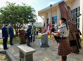 U.S. Air Force Airman 1st Class Kim Tate placed a wreath at the 601st Air Operations Center 9/11 memorial, September 10, 2021, Tyndall Air Force Base, Fla. The 601st AOC held a ceremony to honor the memory of those who lost their lives as a result of the tragic events of September 11, 2001 (Air National Guard photo by, Master Sgt. Regina Young)