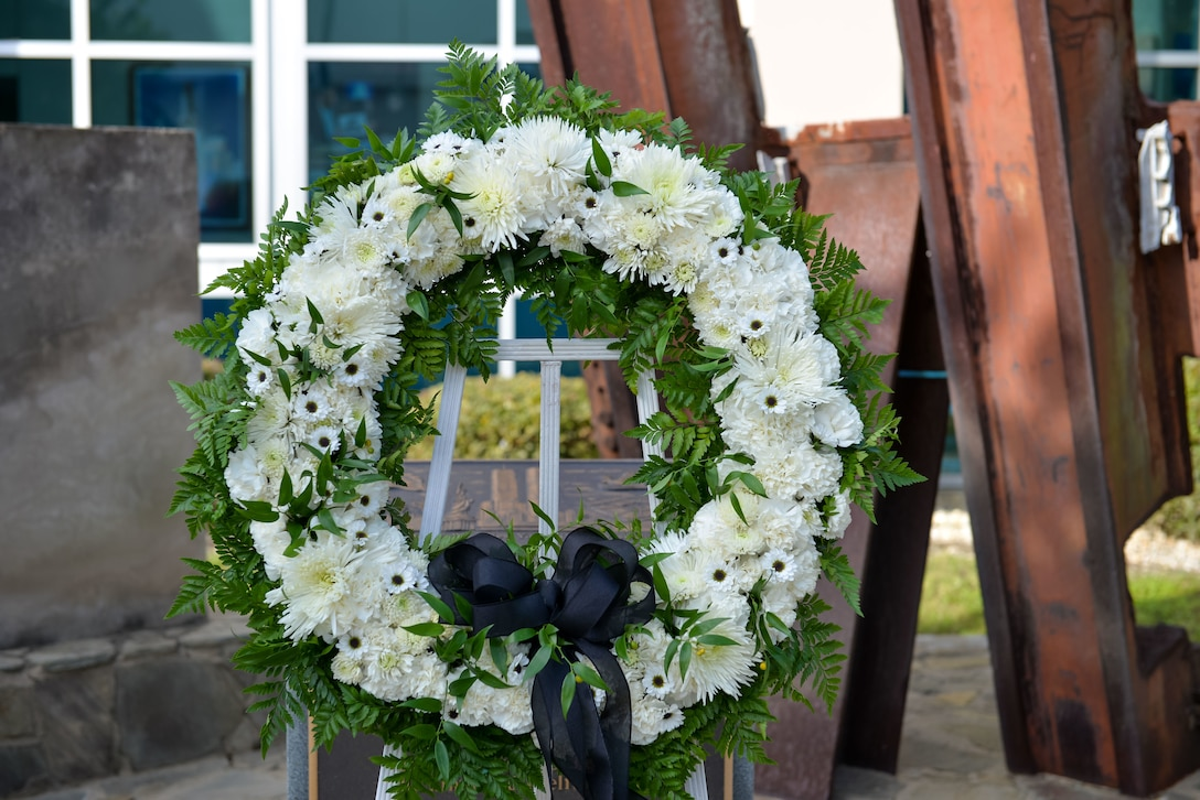 A remembrance wreath lays at the 601st Air Operations Center 9/11 memorial, September 10, 2021, Tyndall Air Force Base, Fla. The 601st AOC held a ceremony to honor the memory of those who lost their lives as a result of the tragic events of September 11, 2001 (Air National Guard photo by, Master Sgt. Regina Young)