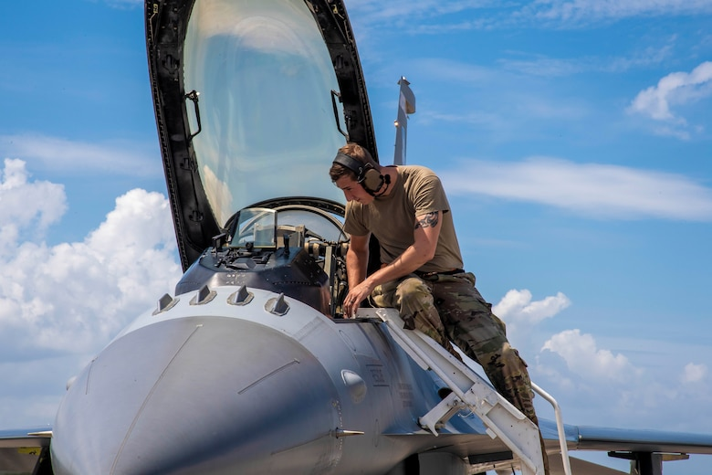 U.S. Air Force Staff Sgt. Chris Rasnick, an avionics technician with the 79th Fighter Squadron, Shaw Air Force Base, South Carolina, performs a preflight check on an F-16 Fighting Falcon aircraft at MacDill Air Force Base, Florida, Sept. 8, 2021.